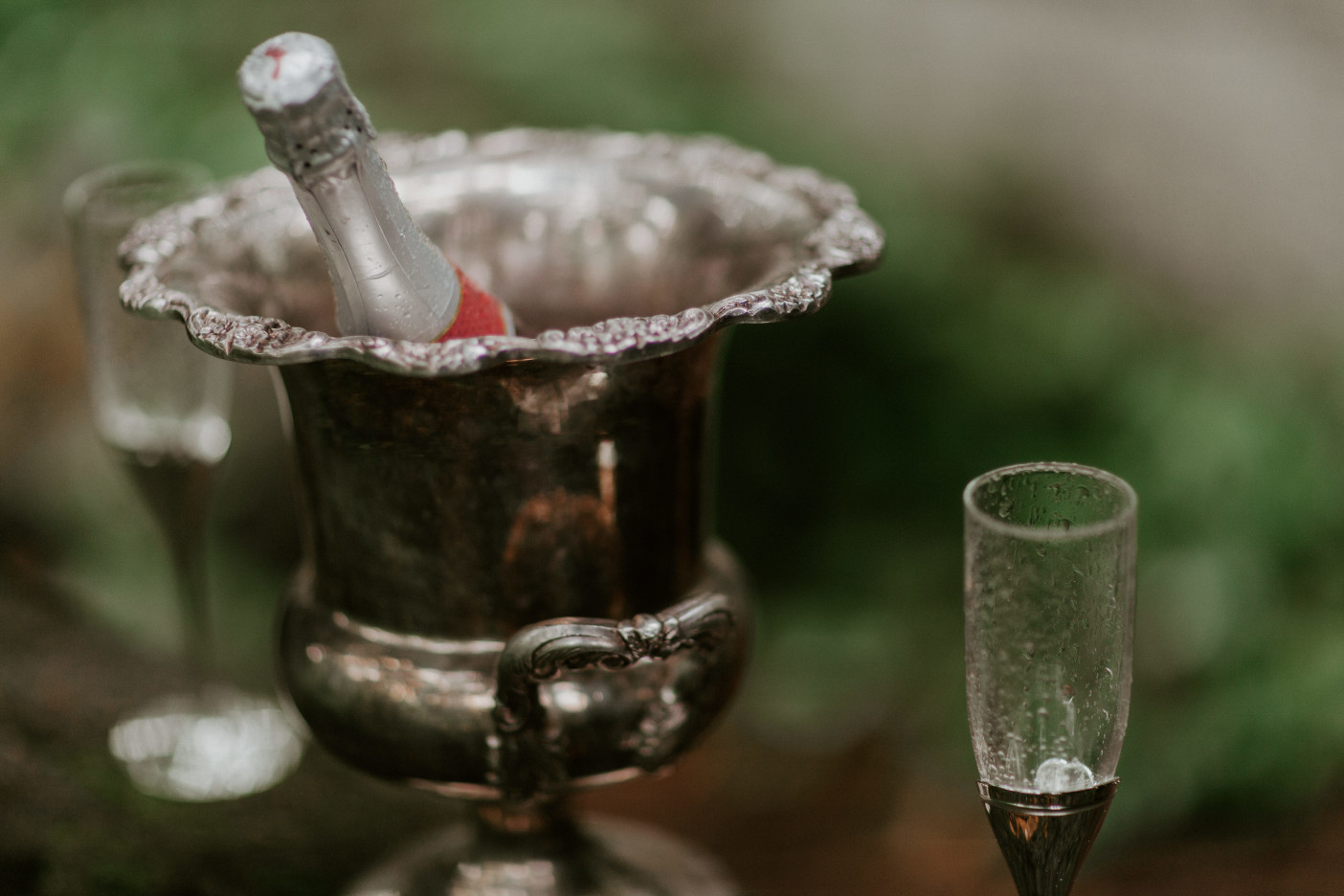 Champagne sits in a chilled silver bucket at Skamania House, Washington. Elopement photography in Portland Oregon by Sienna Plus Josh.