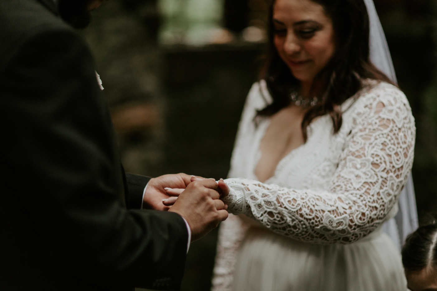 Sam puts a ring on Sarah's finger at Skamania House. Elopement photography in Portland Oregon by Sienna Plus Josh.