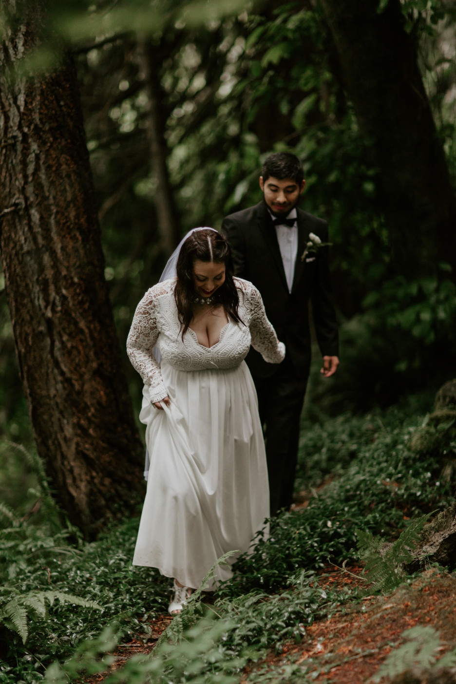 Sarah leads Sam through the woods at Skamania House, Washington. Elopement photography in Portland Oregon by Sienna Plus Josh.