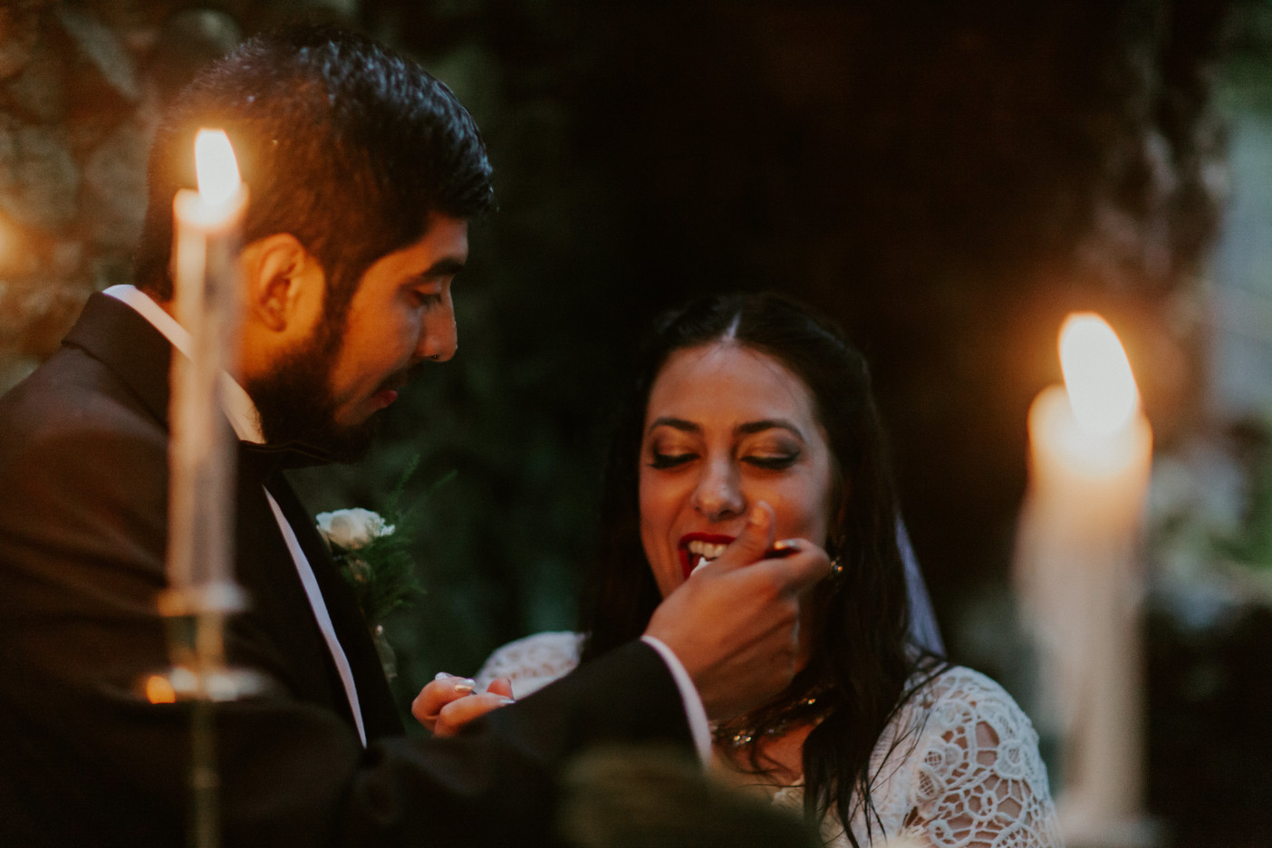 Sarah and Sam feed each other cake at Skamania House, Washington. Elopement photography in Portland Oregon by Sienna Plus Josh.